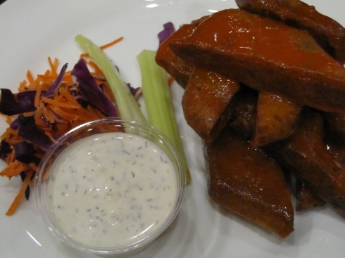"Spicy buffalo seitan ""wings"" with vegan ranch."