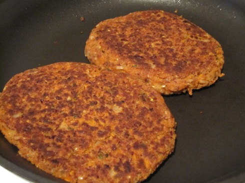 Bean burgers cooking.