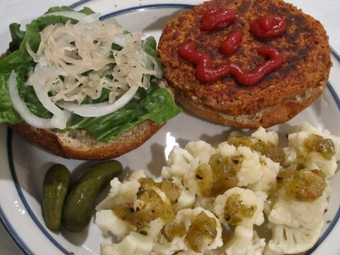 Carrot sunflower bean burger and steamed cauliflower with tomatillo salsa.