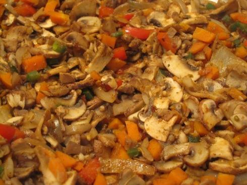 Sauteed crimini mushrooms, veggies & spices.