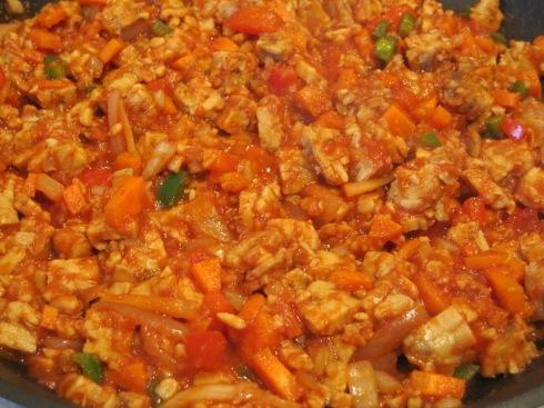 Tempeh, veggies, spices and liquid marinade.