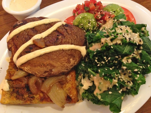 Blackened tempeh-portobello mushroom-caramelized onion stack, steamin' kale, sliced tomato salad, chipotle ranch