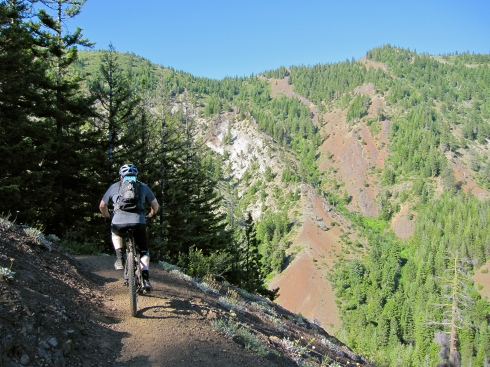 "Eric descends the Iron Creek portion of the Iron Cr/Bear Cr Trail, at the ""don't fall"" section."