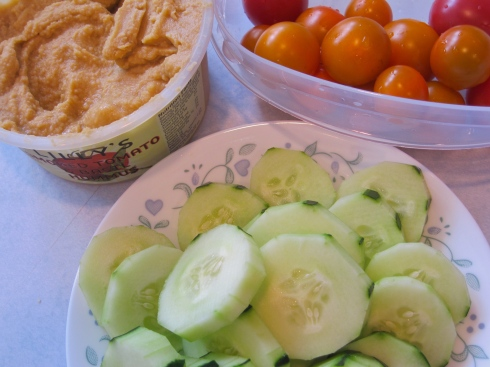 Smoked Tomato & Basil Hummus with cucumbers and cherry tomatoes.