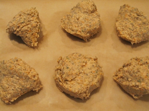 Drop burger batter portions onto a large piece of parchment paper.