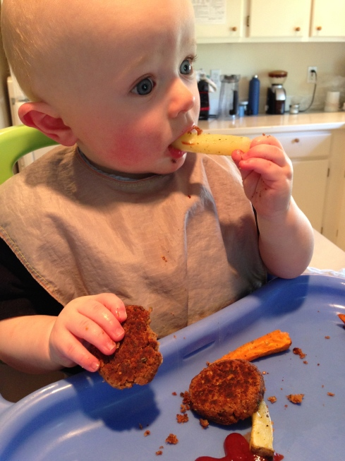 Eating roasted potato and bean burger - 8.5 months old - May 8, 2015