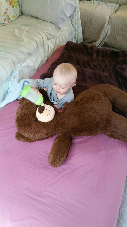 Babysitter pic - Feeding his Pillow Bear - May 4, 2016