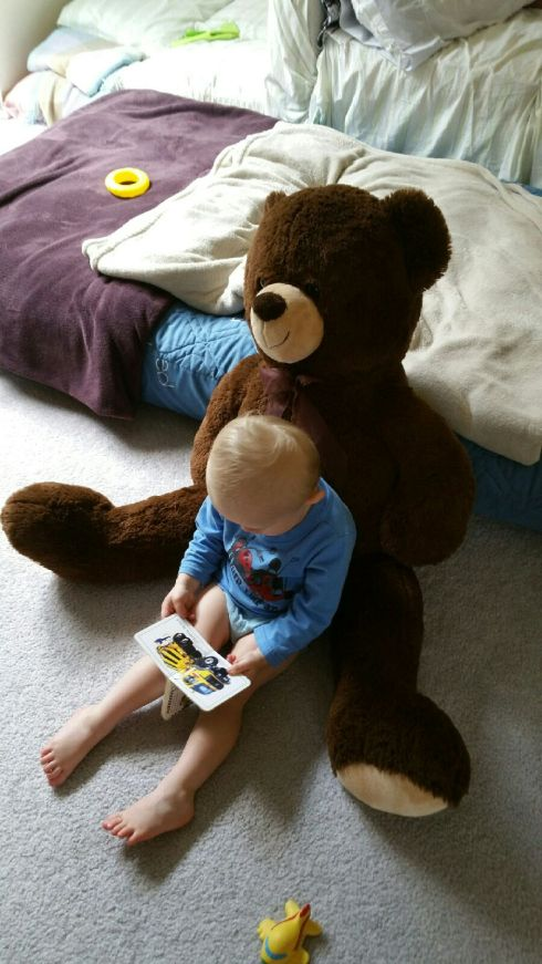 Babysitter pic - reading to his pillow bear - June 21, 2016