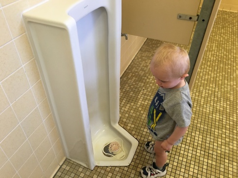 The first public urinal he used, LOL! - August 19, 2016